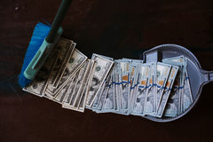 Man rakes in the money in savok. Sweep of the banknote in the trash. Clean money in the trash. Man rakes in the money in savok. Sweep of the banknote in the Royalty Free Stock Photography