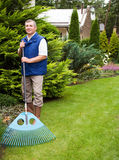 Man raking garden Royalty Free Stock Image