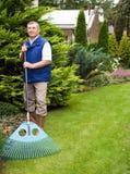 Man raking garden Royalty Free Stock Image