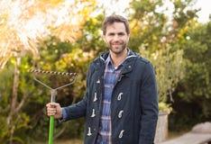 Man raking in his garden Royalty Free Stock Photo