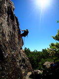 Man rappeling down basalt rock on a sunny day in a California park Royalty Free Stock Image