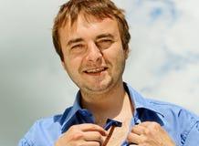 Man with razorblade. Royalty Free Stock Photo