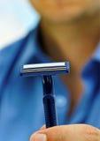 Man with razorblade. Royalty Free Stock Photography