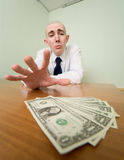Man reaches for a batch of money Stock Image