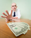 Man reaches for a batch of money Stock Photography