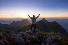 Man reaches the peak of Doi Luang Chiang Dao Stock Photos