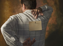 man reaching for communication or note on back stock images