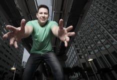 Man reaching down towards the camera Stock Photography