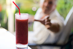Man Reaching For Frozen Drink Royalty Free Stock Photography