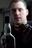 Man Reaching For the Liquor Bottle Stock Images
