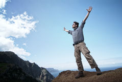 Man reaching out for the sky Stock Image