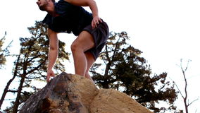 Man reaching the top of his hike stock footage