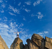 Man reaching top of a mountain Royalty Free Stock Photo