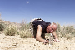 Man Reaching for Water in Desert Stock Image