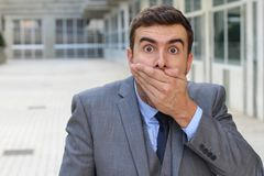 Man reacting after getting a gossip. Nosy man reacting after getting a gossip royalty free stock photos