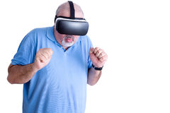 Man reacting to action in virtual headset Stock Photos