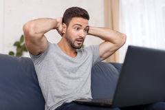 Man read bad news on laptop Stock Images