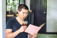 Man read the book. Asian man read the book in the coffee shop stock photography