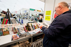 Man read a book on International Book Fair Royalty Free Stock Photography