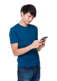 Man read on cellphone Stock Images