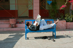 Man read the newspaper at the time of siesta Royalty Free Stock Image