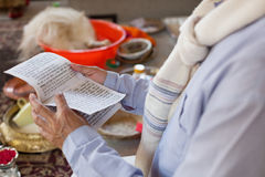 Man Read Prayer Nepal. For baptism Royalty Free Stock Photos