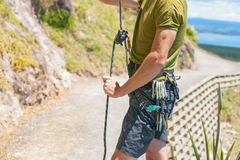 Man readies for climb up a rock face Stock Photo