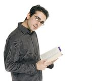Man reading. A man is reading a book and looking at the camera Stock Images