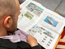 Man reading abouty Queen Mary 2  the transatantic ocean liner, Royalty Free Stock Photography