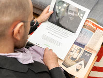Man reading advertising about Android software integration in st Stock Images