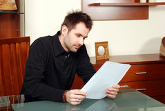 Man is reading agreement. In his office Royalty Free Stock Photos