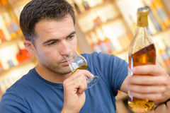 Man reading alcohol label. Man reading the alcohol label Stock Photo