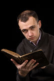 Man reading an antique book Royalty Free Stock Photos
