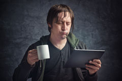 Man Reading Bad News on Digital Tablet Computer Stock Photos