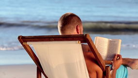 Man reading on the beach Stock Photos