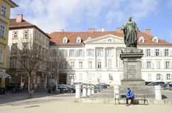 Man reading in a bench in Graz Stock Images