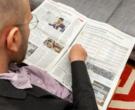 Man reading about the best companies to work for Royalty Free Stock Photography