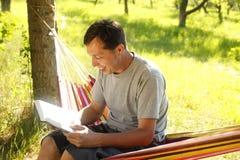 Man reading the Bible Stock Image