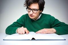 Man reading big book Royalty Free Stock Images
