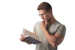 Man Reading Big Book Isolated on White Background Stock Photo