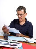 Man Reading a Bill in Shock and Disbelief Stock Images
