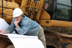 Man reading blueprint Stock Photography