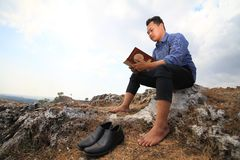 Man Reading a Book stock images
