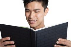Man reading book Stock Photos