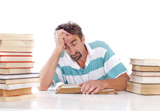 Man reading a book. Man tired of reading books Royalty Free Stock Photography