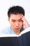 Man reading book Stock Photography