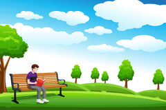 Man reading a book on the bench Stock Photo