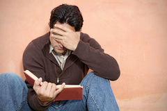 Man reading book or bible Royalty Free Stock Photos