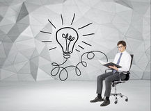 Man reading a book. A businessman sitting on a castor chair and reading a book, a bulb connected with the book drawn to the left. Grey geometric background Royalty Free Stock Image