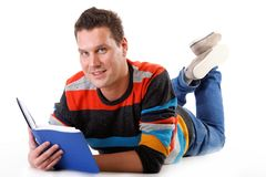 Man reading a book on the floor isolated Royalty Free Stock Photo